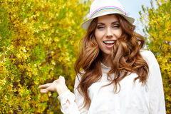 Spring woman in summer day. Walking in yellow park stock photos