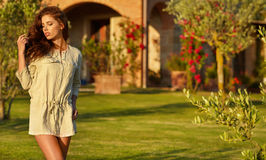 Spring woman a summer  time walking in green garden Royalty Free Stock Photos