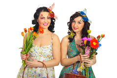Spring women with fresh flowers Stock Images