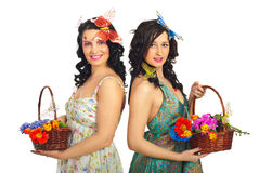 Spring women holding flowers baskets Stock Image