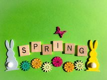 Creative concept : the word Spring in 3d wooden alphabet letters royalty free stock photo