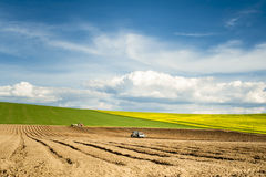Spring works on fields Stock Photos