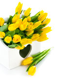 Spring yellow tulips in wooden basket Royalty Free Stock Photos