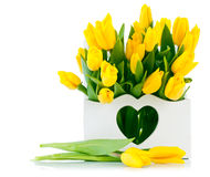 Spring yellow tulips in wooden basket Royalty Free Stock Photography