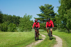 Spring - Young couple cycling in a nature Royalty Free Stock Photo