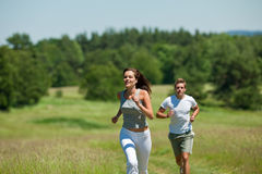 Spring - Young couple jogging in the nature Stock Photography