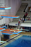 Springboard for jumps in water in sport complex Stock Photos