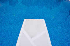 Springboard in the pool Royalty Free Stock Photos
