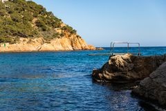 Springboard from shore rocks into the ocean stock image