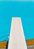 Springboard on swimming pool royalty free stock photos