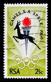 Springbok, Torch and Rings, South African National Games serie, Bloemfontein, circa 1969. MOSCOW, RUSSIA - OCTOBER 1, 2017: A stamp printed in South Africa shows Stock Images
