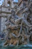 Springbrunn av de fyra floderna i bakgrunden den kyrkliga Santen Agnese i piazza Navona i Rome Fotografering för Bildbyråer