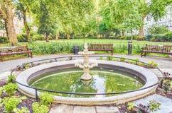 Springbrunn i Sts George fyrkant, London Fotografering för Bildbyråer