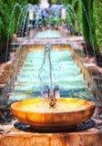 Springbrunn i trädgården Arkivbild