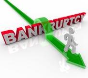 Springen über den Wort-Bankrott Stockfotos