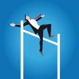Springen über Hindernis des Geschäfts Stockbild