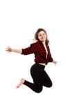 Springen der jungen Frau Stockfotos
