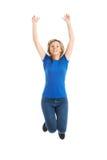 Springen der jungen Frau in voller Länge Lizenzfreies Stockfoto