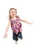 Springen des kleinen Mädchens stockbild