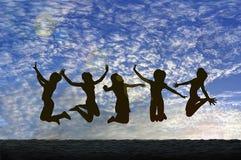 Springen mit Freude Stockbilder
