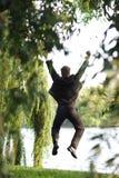 Springen Sie in den Park Stockfotografie