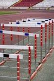 Springen Sie Zaun Stockfoto
