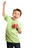 Springend kind dat gezond vruchtesap houdt stock afbeeldingen