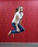 Springend meisje stock foto