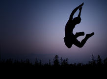 Springend silhouet Stock Afbeelding