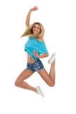 Springende blonde Frau Stockbild