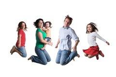 Springende familie Stock Afbeelding