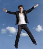 Springende Geschäftsfrau lizenzfreies stockbild