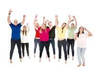 Springende glückliche Leute Lizenzfreie Stockfotografie