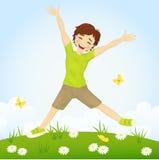 Springende jongen Stock Afbeeldingen