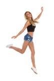 Springende junge Frau Stockfoto