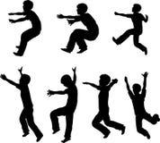 Springende Jungen-Schattenbilder Stockbilder