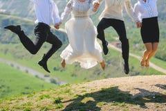 Springende Leute Stockbild