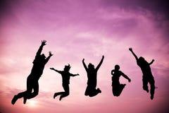 Springende Leute für genießen mit ihrer Reise Stockfoto