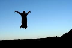 Springende mens stock foto's