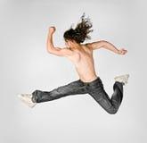 Springende mensen Stock Afbeeldingen