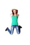 Springende tienerstudent die o.k. gebaar toont Royalty-vrije Stock Fotografie