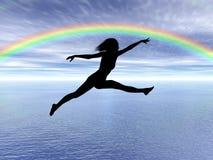 Springende vrouw in de regenboog Royalty-vrije Stock Foto