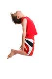 Springender aktiver Junge Stockbild