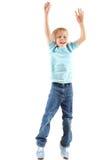 Springender freundlicher Junge Stockfoto