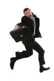 Springender junger Geschäftsmann Stockfotos