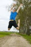 Springender Sportler Stockbild