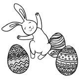 Springendes Häschen und Eier Stockbild