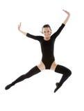 Springendes Mädchen im schwarzen Trikotanzug Lizenzfreie Stockfotos