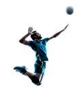 Springendes Schattenbild des Mannvolleyball Stockfoto
