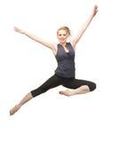 Springendes sportliches Mädchen Stockfoto